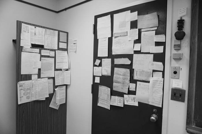 Papers on door to Jim Darnell's office