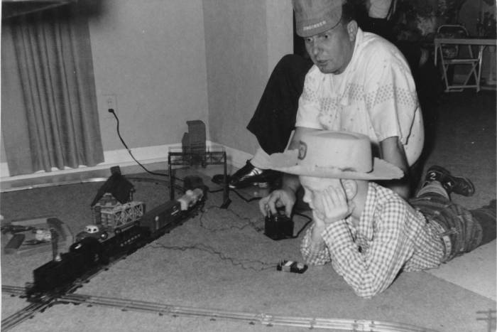Mike Young and his father, Lloyd, playing with a train set in the 1950s