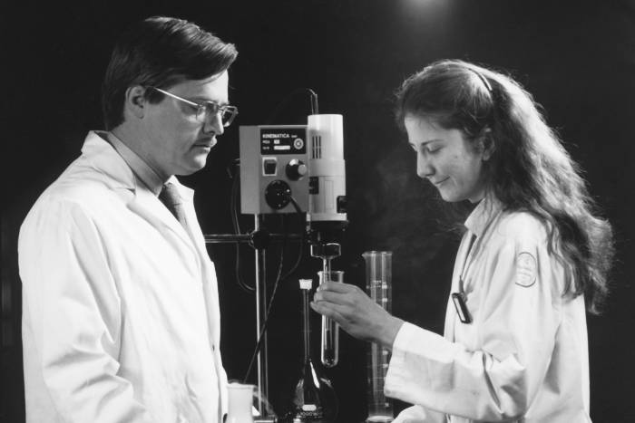 Portrait of Bruce McEwen in lab with colleague
