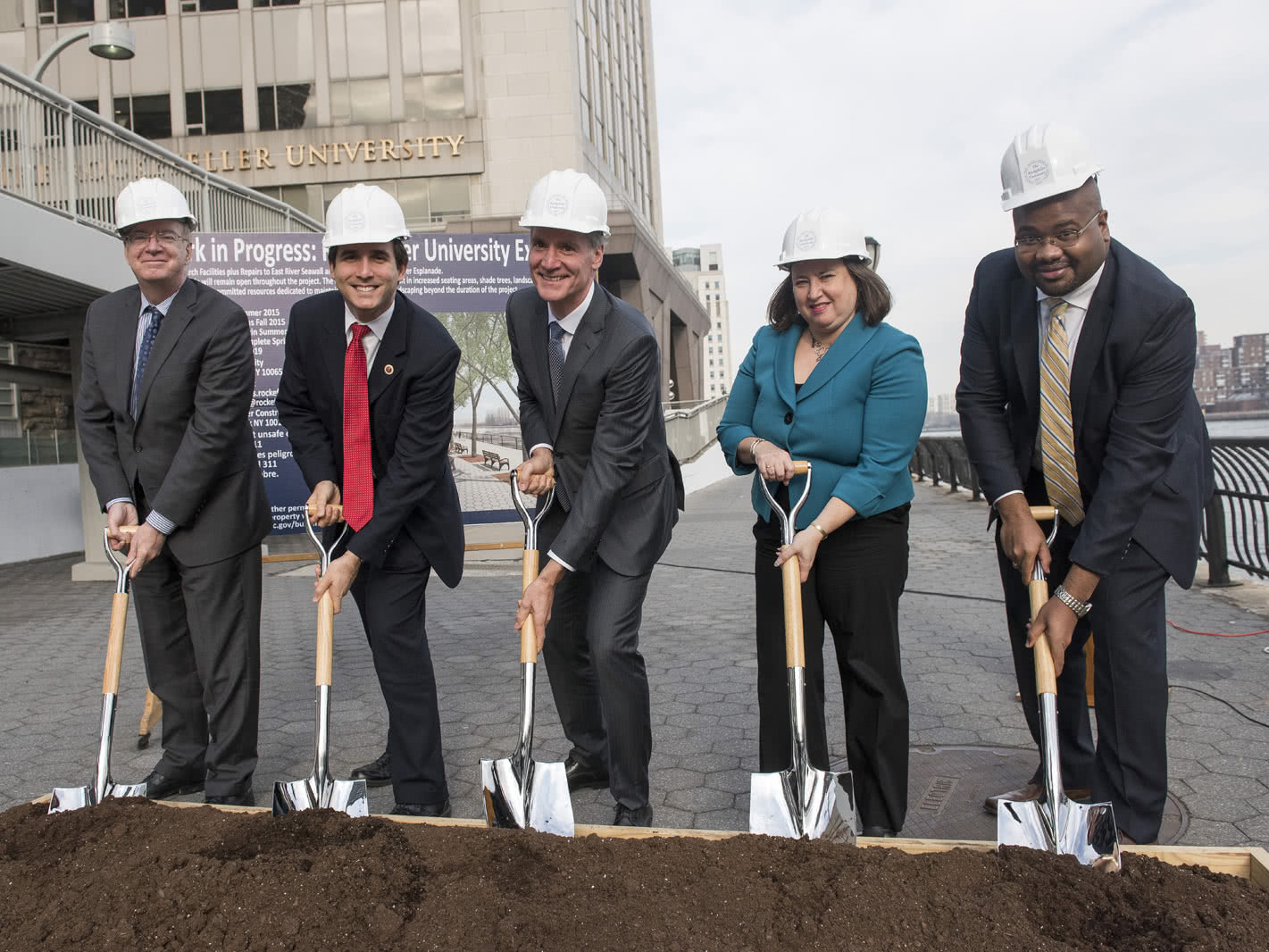 Breaking ground: (From left to right) Bill Castro, Benjamin Kallos, Marc Tessier-Lavigne, Minna Elias, and Matthew Washington celebrate as the project to repair the seawall near Rockefeller and to revitalize the East River Esplanade commences.