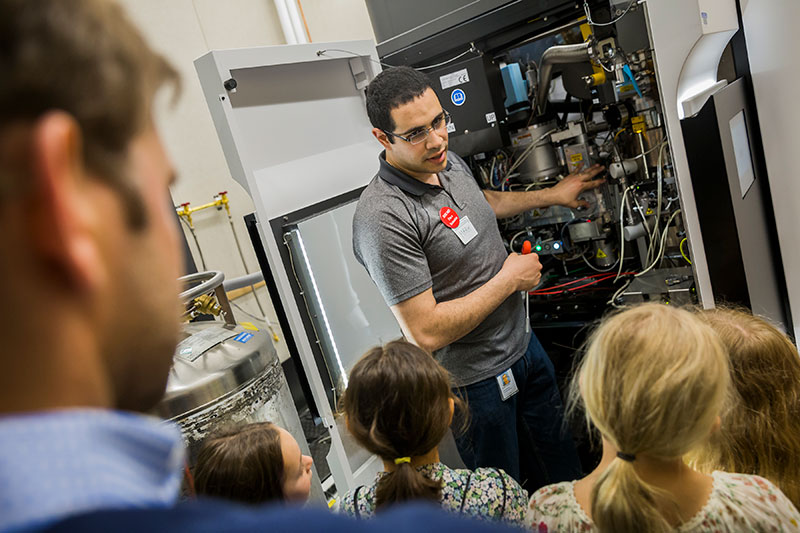 Senior staff scientist Mark Ebrahim shows the inside of a microscope during a tour of the Cryo-Electron Microscopy Center. Cryo-EM uses beams of electrons to image protein samples that have been flash-frozen at cryogenic temperatures, revealing their atomic structures.