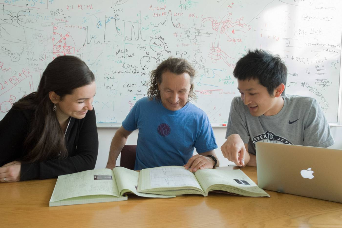 MacKinnon with students doing research