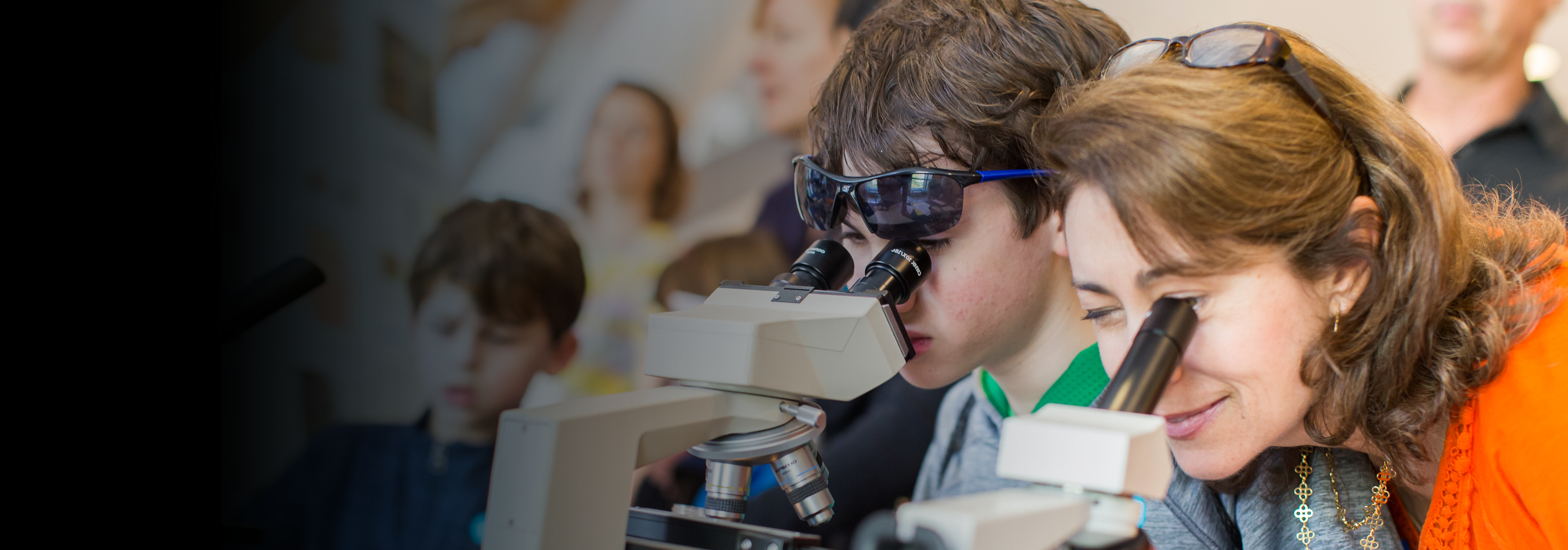 Student and teacher at microscope