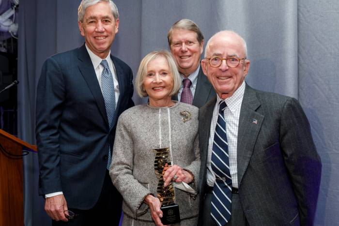 Pat and John Rosenwald (front) accepting the 2018 Enlightened Philanthropy Award from Rick Lifton (back left) and Russ Carson