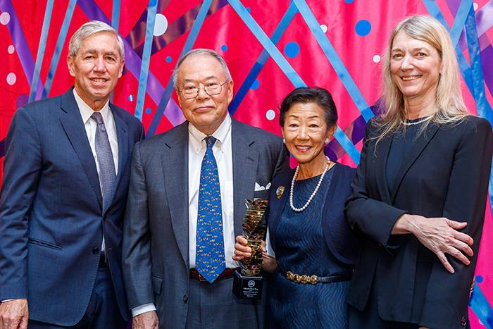 Honorees Lulu and Tony Wang (center) accepting the 2019 Enlightened Philanthropy Award from Rick Lifton (left) and Cori Bargmann (right)